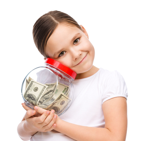 girl smiling with savings jar